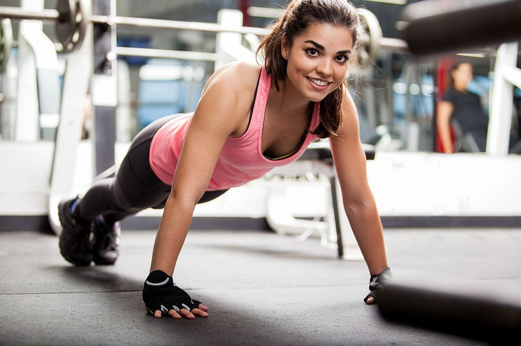 smiling woman doing a push up