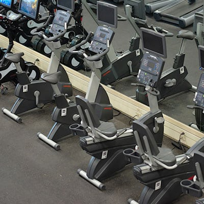 row of neatly placed cardio machines in a row