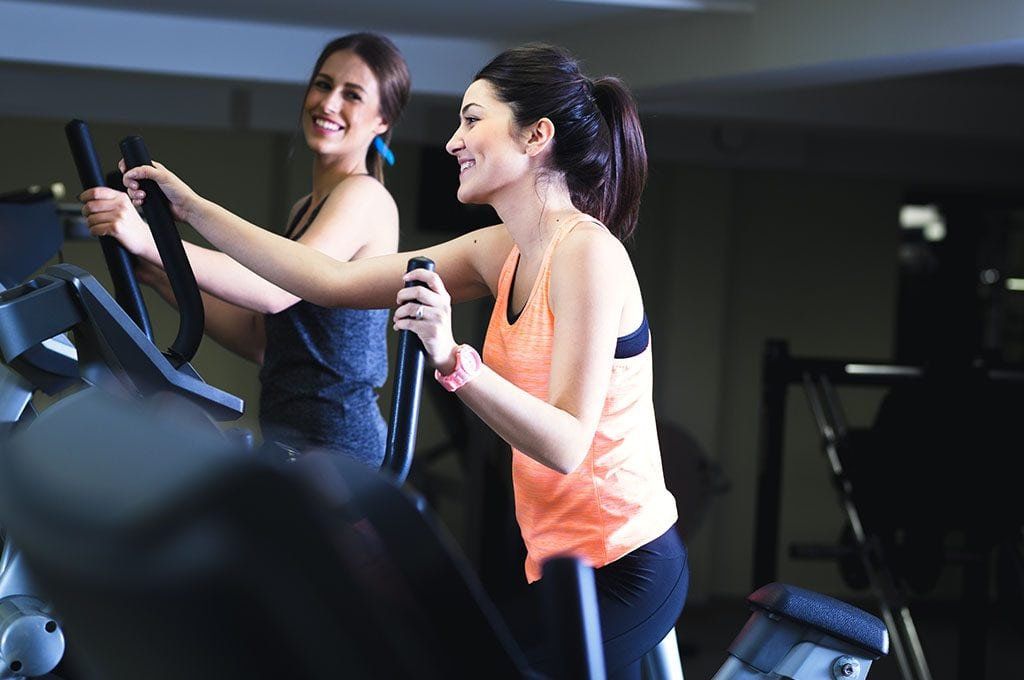 2 women working out on stair climber