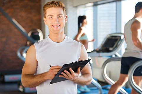 handsome red headed personal trainer smiling