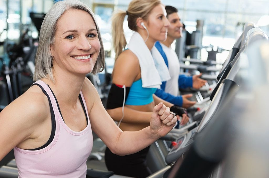 smiling woman on a cardio machine