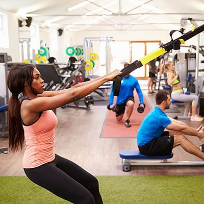 group of people on a circuit training course using TRX bands