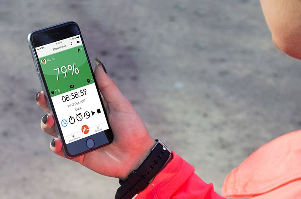 woman's hand holding aa mobile phone showing the MYZONE fitness tracking app
