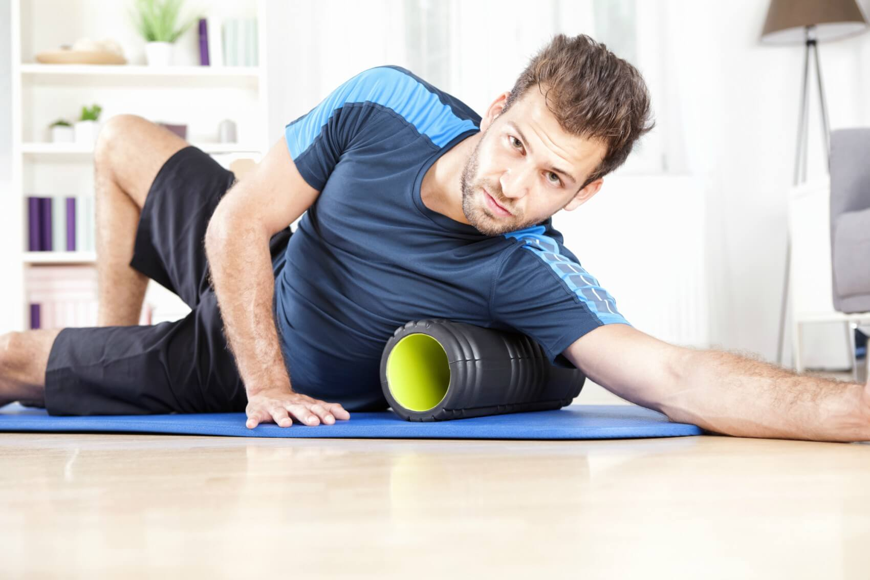 5 Foam Rolling Benefits That Will Make You Want to Roll Tonight