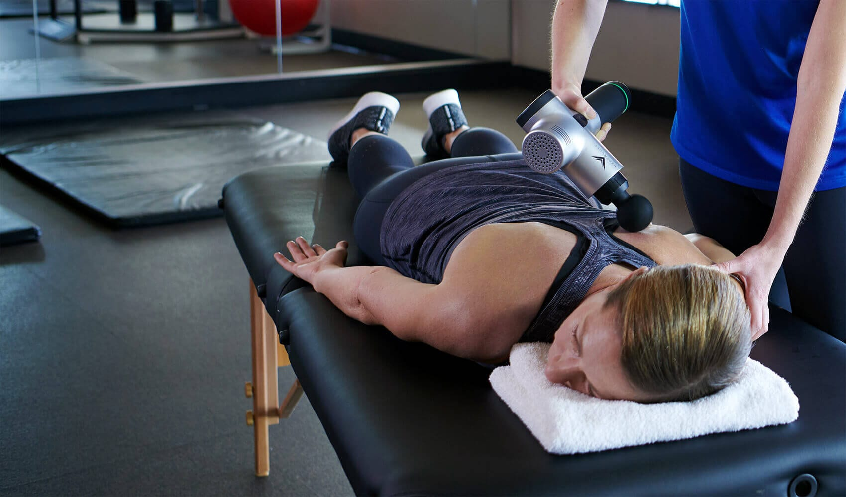 brick bodies gym member receiving massage therapy