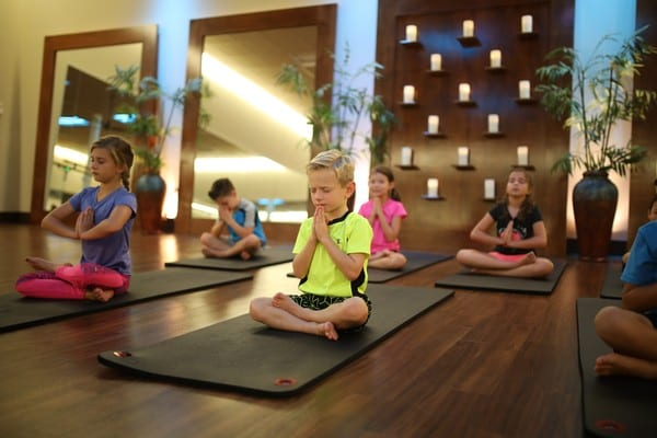 children in youth fitness yoga classes at brick bodies gyms