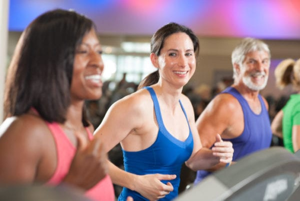 fitness members smiling while cardio training at reistertown gym