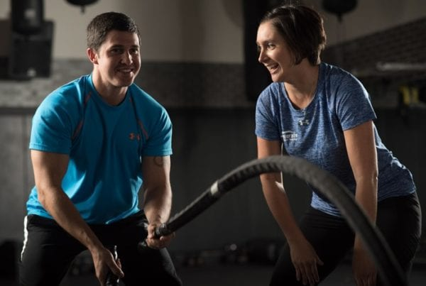personal trainer encouraging male gym member at rotunda