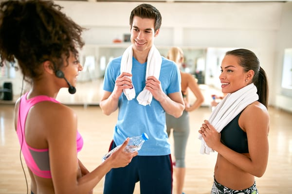 fitness instructor at brick bodies gym sharing fitness tips in group fitness class