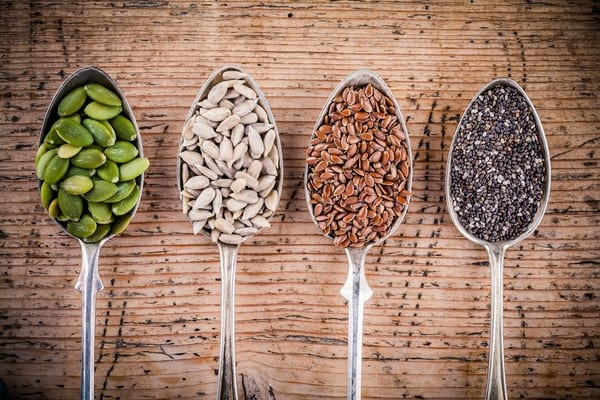 spoons with seeds from brick bodies nutrition tips on what seeds are great to incorporate into diet