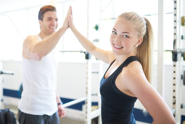 couple high fiving at brick bodies rotunda gym