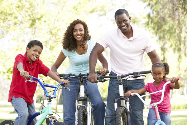 young family using brick bodies gyms tip to outdoor exercise using bicycles