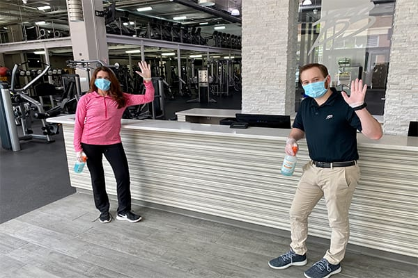 gym employees waving at service desk after cleaning in rotunda