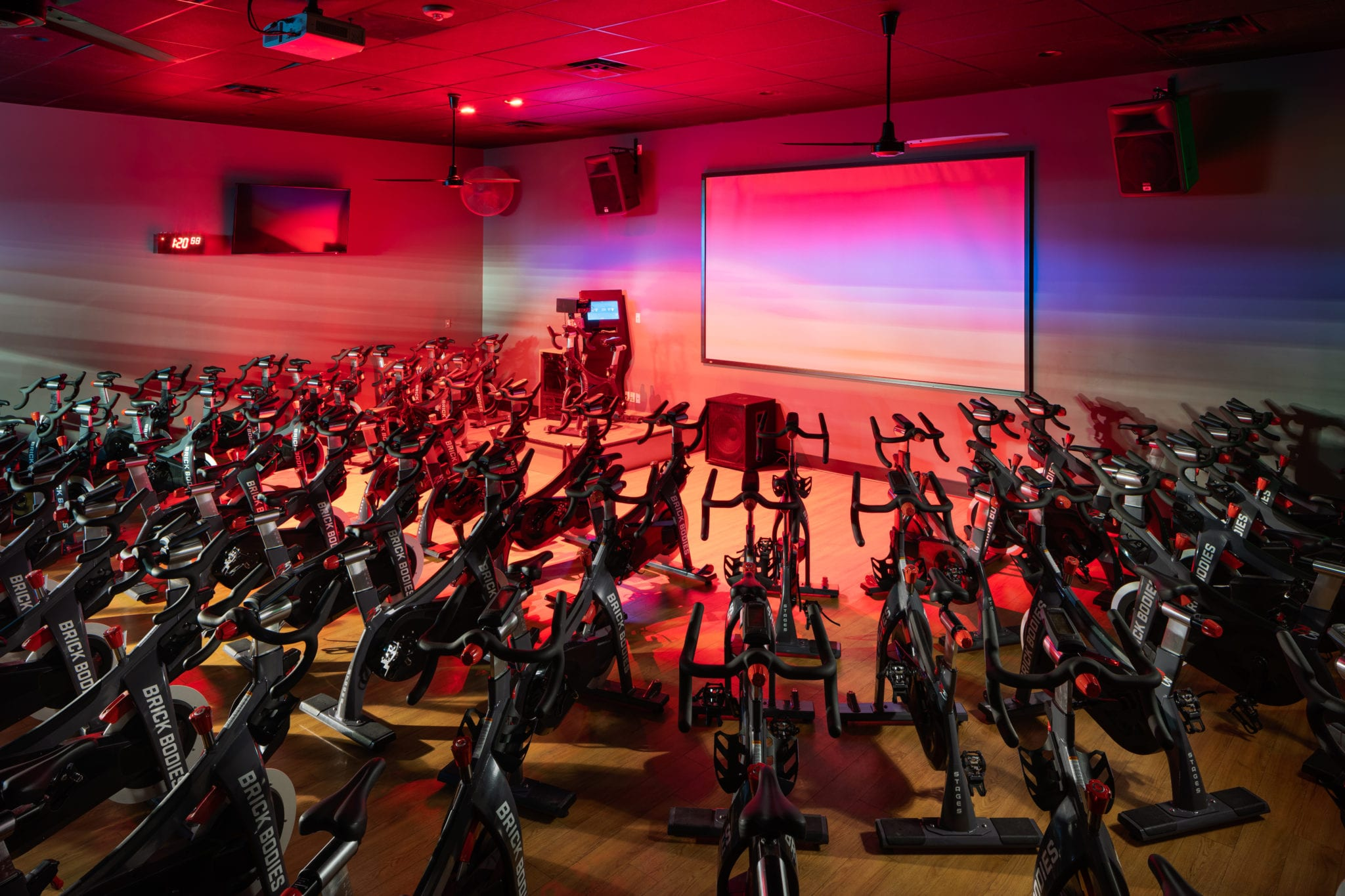 spin class inside modern cycling studio in padonia gym