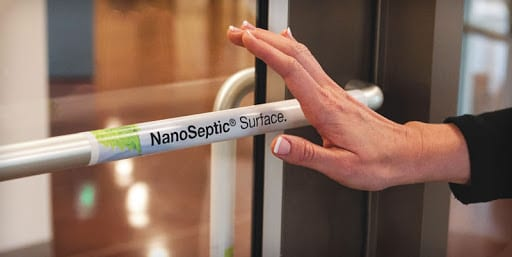 hand reaching for nanoseptic surface door at brick bodies gyms