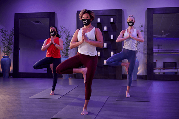 women working out in yoga studio at clean gym wearing brick bodies gym masks
