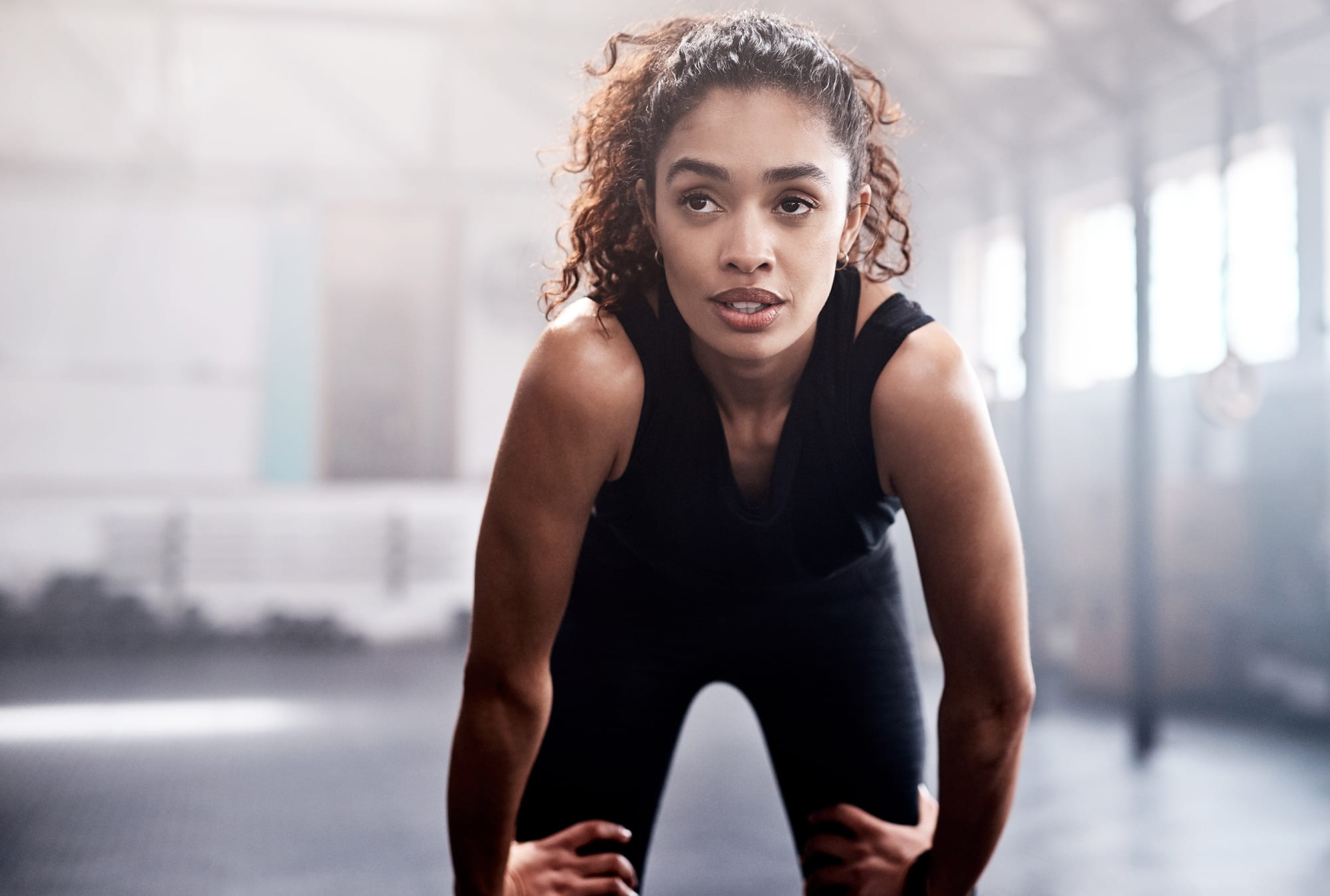 woman resting after intense workout in gym