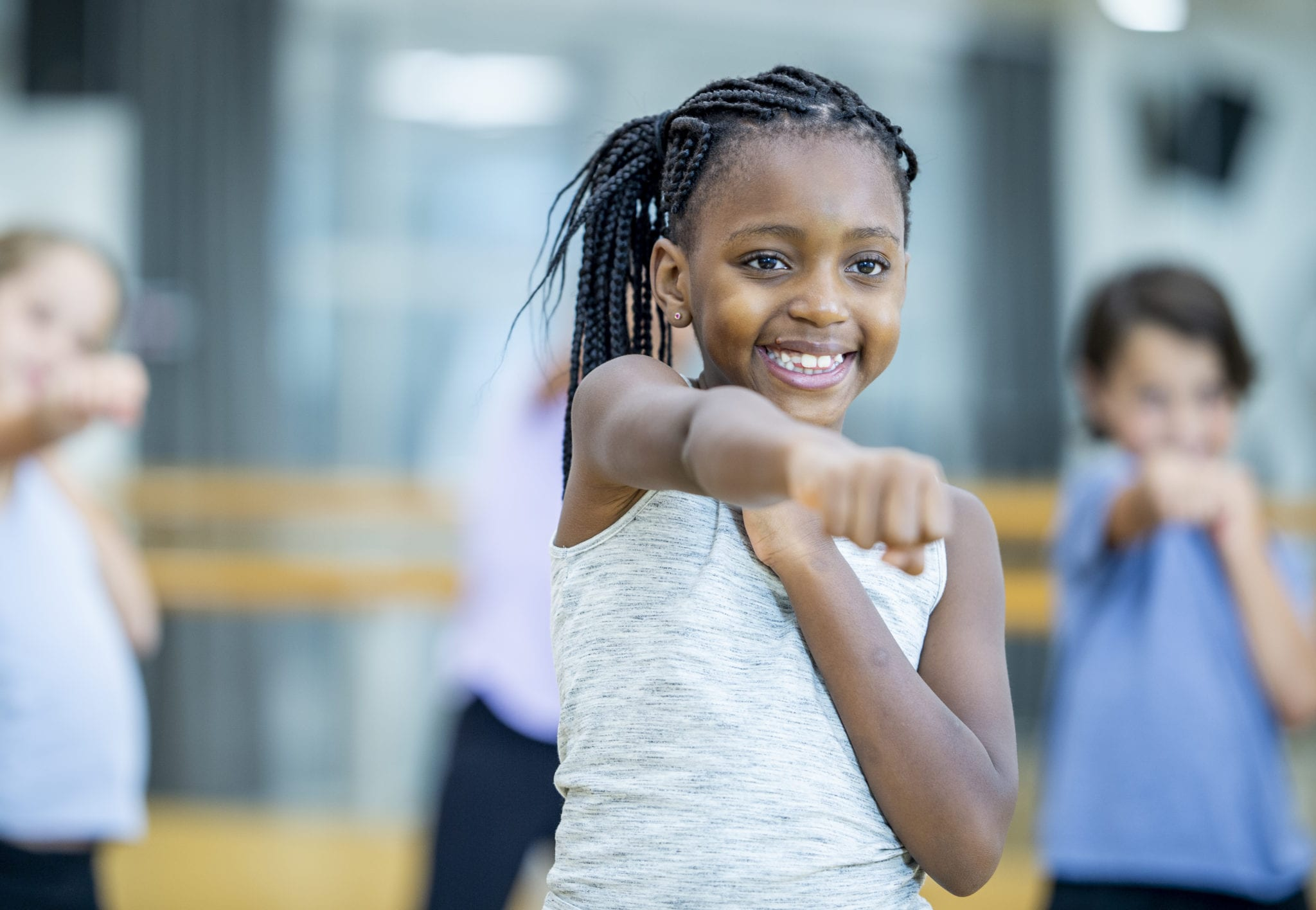 african american girl working out in group youth fitness class at brick bodies gym
