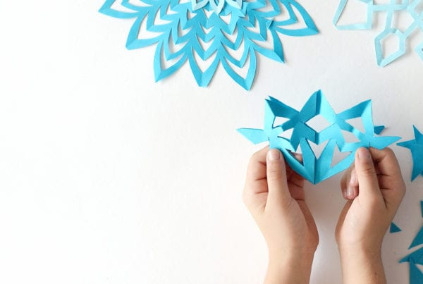 paper snowflake crafts created by children in gym childcare
