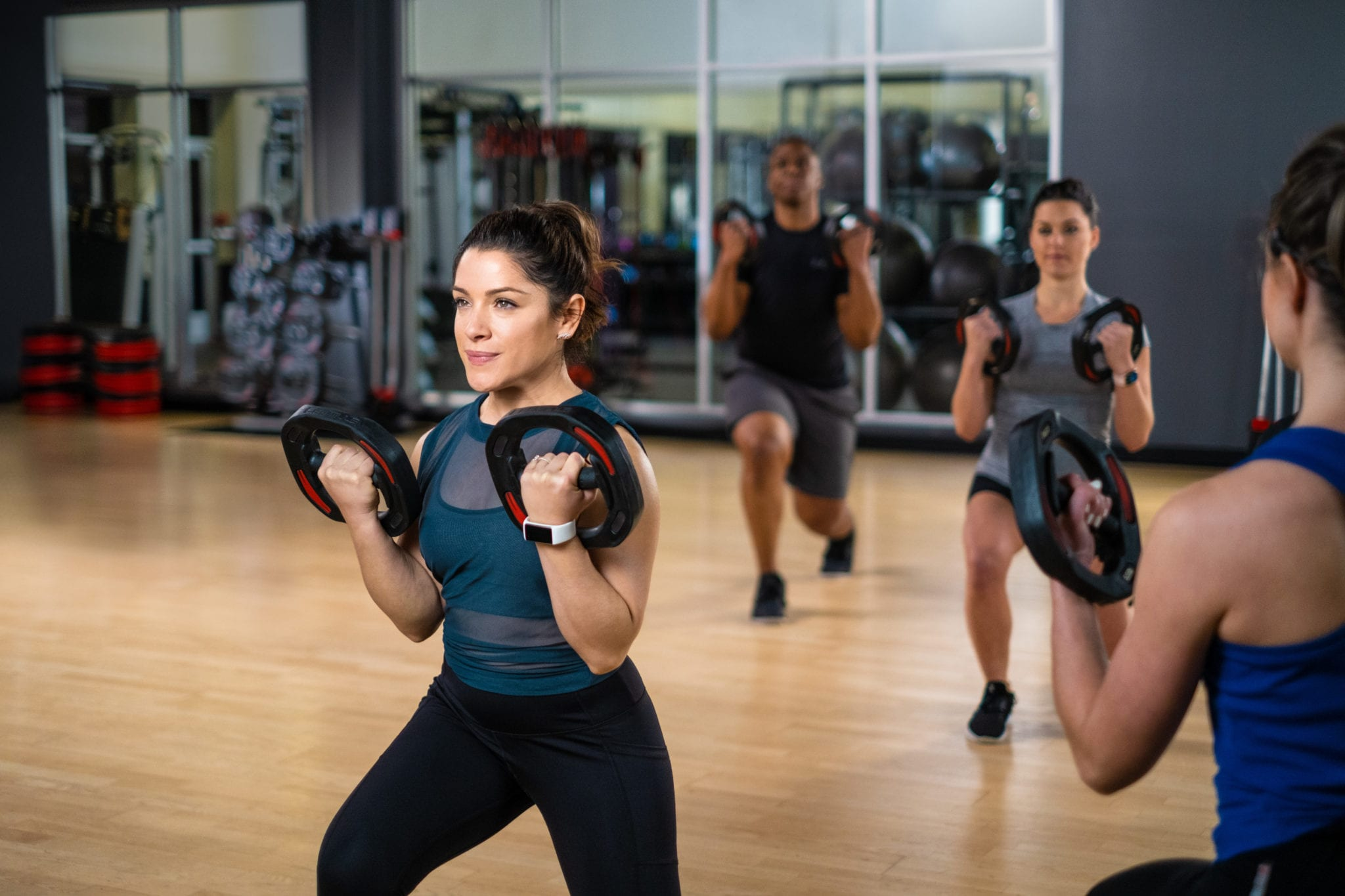 fitness instructor using weights during les mills group classes at padonia gym