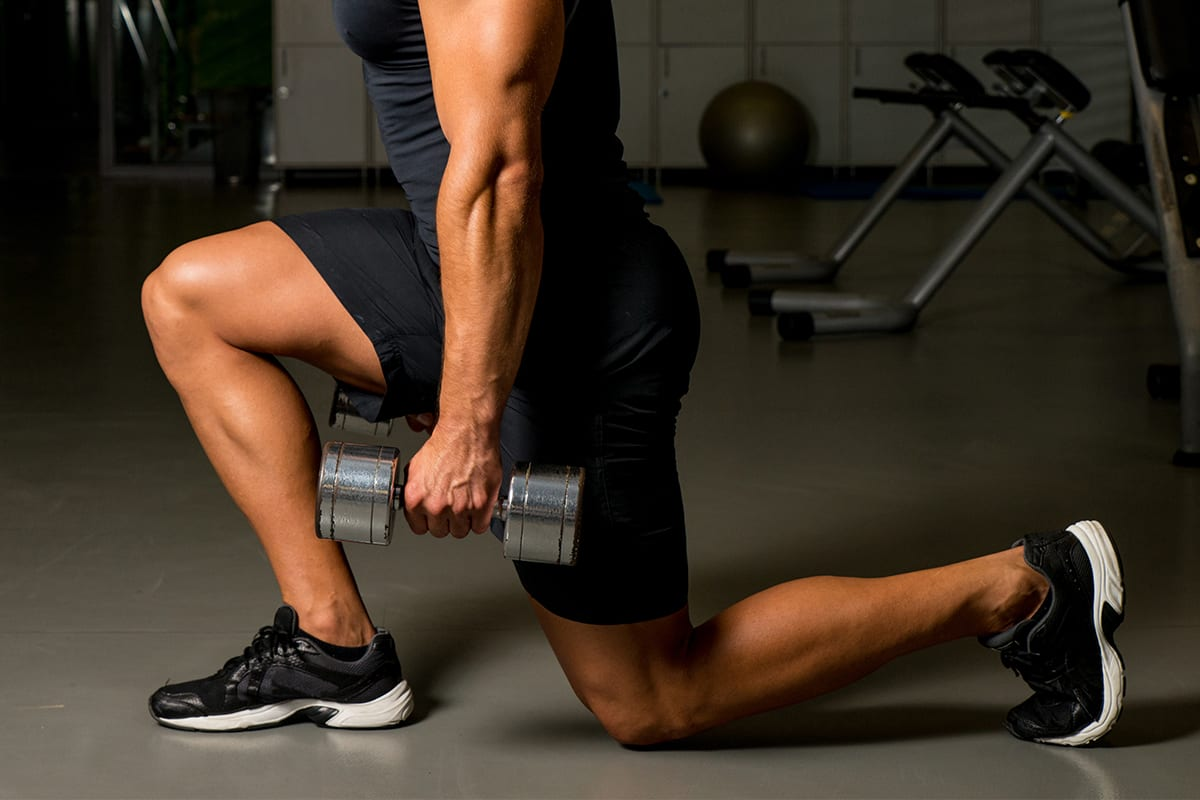 leg workout with dumbbells at gym